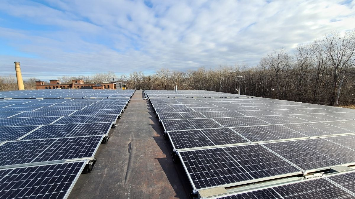 Solar panels generating energy for Select in Burlington Vermont installed by Green Mountain Solar