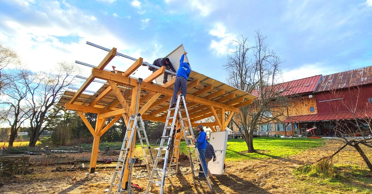 Green Mountain Solar installing solar on a wooden carport